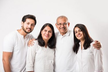 happy-indian-family-of-four-standing-isolated-over-white-background-2403579-2023358
